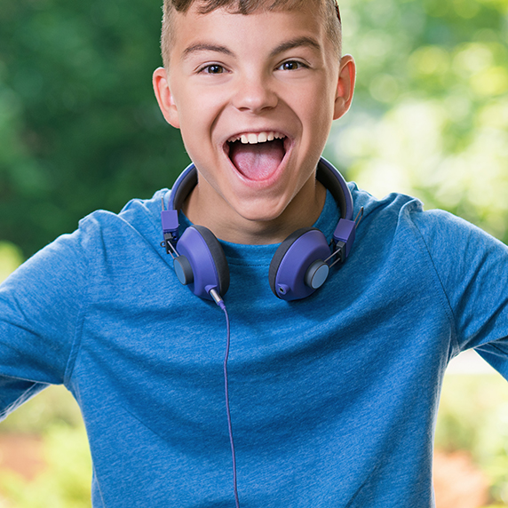 Teen boy laughing